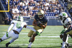 Navy wide receiver Jayden Umbarger (87) runs the ball against Marshall defensive back Micah Abraham (6) during the first half of an NCAA college football game, Saturday, Sept. 4, 2021, in Annapolis, Md. (AP Photo/Terrance Williams)