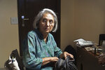 Ma Anand Sheela, spokeswoman for the controversial Osho spiritual movement in the 1980's, gets ready to meet her fans in New Delhi, India, Friday, Nov. 1, 2019. Ma Anand Sheela, who helped controversial Indian mystic Bhagwan Shree Rajneesh set up a commune in Oregon in the 1980's and was a subject of the hit series Wild Wild Country, will star in a new documentary filmed during her first trip to India in 34 years. (AP Photo/ Krithika Varagur)