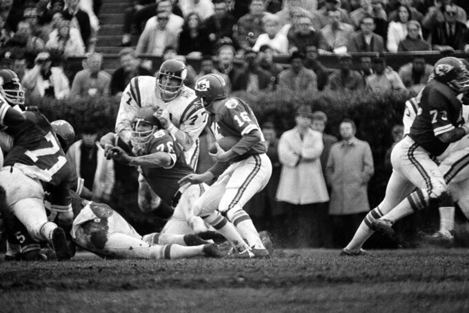 FILE - In this Jan. 11, 1970, file photo, Kansas City Chiefs quarterback Len Dawson (16) holds the ball as Mo Moorman blocks Minnesota Viking's defensive tackle Gary Larson (77) during the Super Bowl 4 football game in New Orleans. The Chiefs beat the Vikings 23-7. (AP Photo/File)