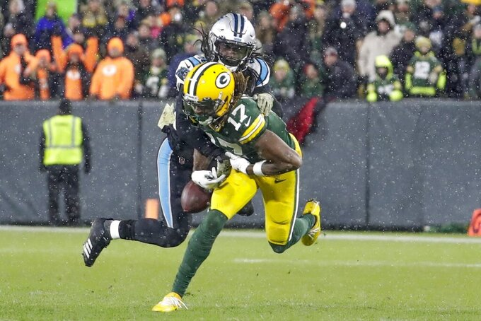 Carolina Panthers' Donte Jackson breaks up a pass intended for Green Bay Packers' Davante Adams during the second half of an NFL football game Sunday, Nov. 10, 2019, in Green Bay, Wis. (AP Photo/Morry Gash)