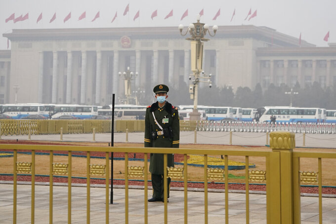 "A Chinese paramilitary policeman stands watch near the Great Hall of the People where the annual National People's Congress is held in Beijing on Friday, March 5, 2021. The ruling Communist Party is aiming for economic growth ""over 6%"" as it rebounds from the coronavirus pandemic, Premier Li Keqiang said in a speech at China's ceremonial legislature Friday. (AP Photo/Ng Han Guan)"