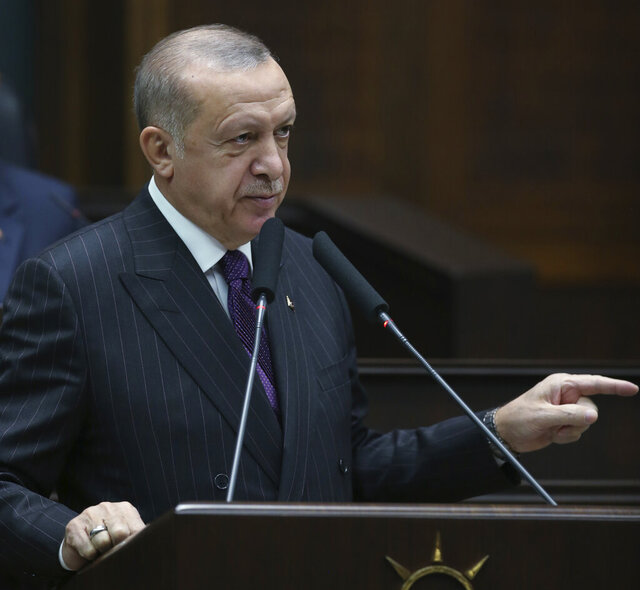 Turkish President Recep Tayyip Erdogan addresses the mmbers of his ruling party at the parliament, in Ankara, Turkey, Wednesday, Oct. 14, 2020. Erdogan on Wednesday accused Greece and Cyprus of failing to fulfill