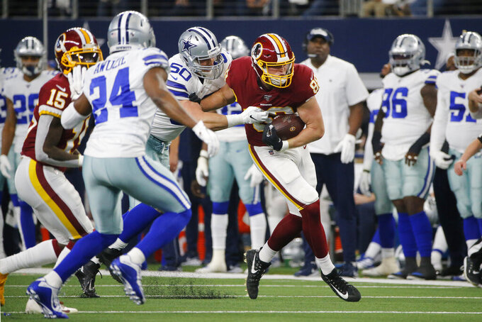 Washington Redskins wide receiver Cam Sims (89) is hit by Dallas Cowboys outside linebacker Sean Lee (50) after a catch during the first half of an NFL football game in Arlington, Texas, Sunday, Dec. 15, 2019. (AP Photo/Michael Ainsworth)