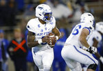 Air Force quarterback Donald Hammond III rolls out to pass the ball against Utah State in the first half of an NCAA college football game Saturday, Oct. 26, 2019, at Air Force Academy, Colo. (AP Photo/David Zalubowski)
