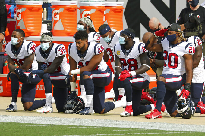 Houston Texans players, from left, Cornell Armstrong (30), Keion Crossen (35), Nate Hall (48), Michael Thomas (28) and Justin Reid (20) kneel during the national anthem before an NFL football game against the Jacksonville Jaguars, Sunday, Nov. 8, 2020, in Jacksonville, Fla. (AP Photo/Stephen B. Morton)