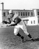 FILE - In this 1946 file photo, Los Angeles Rams' Woody Strode, catches a football. Strode overcame prejudice in pro football and then had a productive career acting in Hollywood action films. (AP Photo/File)