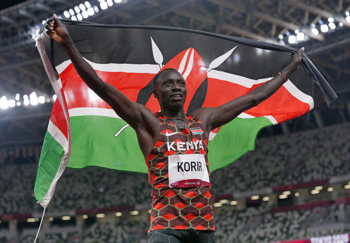 Emmanuel Korir, of Kenya, celebrates after he won the gold medal in the final of the men's 800-meter at the 2020 Summer Olympics, Wednesday, Aug. 4, 2021, in Tokyo, Japan. (AP Photo/Francisco Seco)