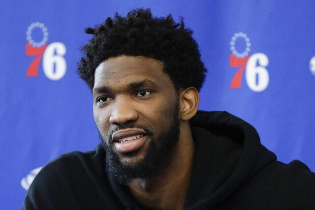 FILE - Philadelphia 76ers' Joel Embiid speaks with members of the media during a news conference at the NBA basketball team's practice facility in Camden, N.J., in this Monday, May 13, 2019, file photo. Knocked his entire career for conditioning woes, Embiid dedicated his offseason to a fitness program he vowed would keep him with the 76ers. Embiid kept his personal transaction wire humming in the shortened offseason with the additions of a personal chef, nutritionist, physical therapist and a massage therapist to shape the 6-foot-11 center into MVP form.(AP Photo/Matt Rourke, File)
