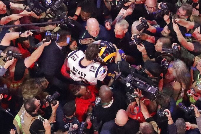 New England Patriots' Tom Brady (12) hugs Los Angeles Rams quarterback Jared Goff after the NFL Super Bowl 53 football game Sunday, Feb. 3, 2019, in Atlanta. The Patriots won 13-3. (AP Photo/Morry Gash)
