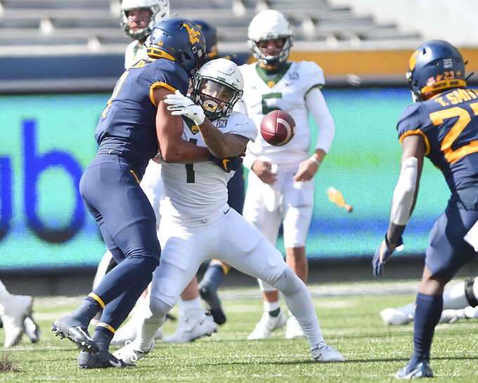 West Virginia linebacker Tony Fields II (1) breaks up the pass intended for Baylor running back Trestan Ebner (1) during an NCAA college football game, Saturday, Oct. 3, 2020, in Morgantown, W.Va. (William Wotring/The Dominion-Post via AP)