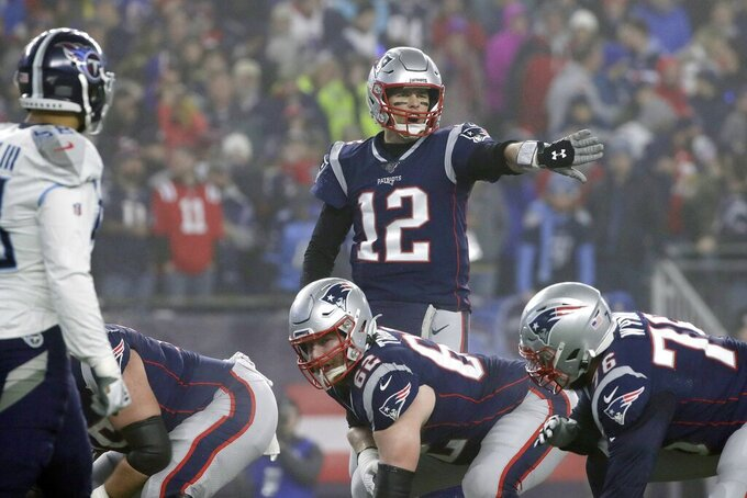 New England Patriots quarterback Tom Brady calls signals at the line of scrimmage in the first half of an NFL wild-card playoff football game against the Tennessee Titans, Saturday, Jan. 4, 2020, in Foxborough, Mass. (AP Photo/Elise Amendola)