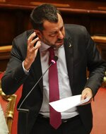 Italian Deputy-Premier and Interior Minister, Matteo Salvini, gestures as he addresses the Senate in Rome, Thursday, July 11, 2019. Opposition lawmakers want to question Italian Interior Minister Matteo Salvini about allegations a Russian oil deal was devised to fund his pro-Moscow League party. Democratic Party lawmakers are demanding that a parliamentary inquiry be held. (AP Photo/Gregorio Borgia)