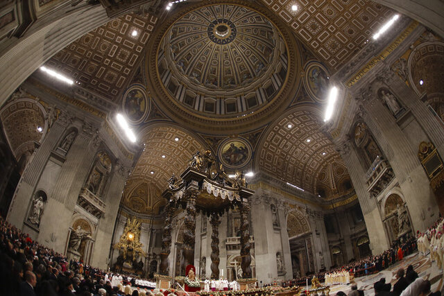 "FILE - In this Tuesday, Dec. 24, 2019 file photo, Pope Francis celebrates Christmas Eve Mass in St. Peter's Basilica. Vatican prosecutors have ordered the seizure of documents and computers from the administrative offices of St. Peter's Basilica in an apparently new investigation into financial irregularities in the Holy See. The Vatican said Tuesday that Pope Francis has also named a special commissioner to run the basilica, reorganize its offices, update its statutes to comply with new Vatican norms on procurement contracts and to ""clarify its administration."" (AP Photo/Alessandra Tarantino)"