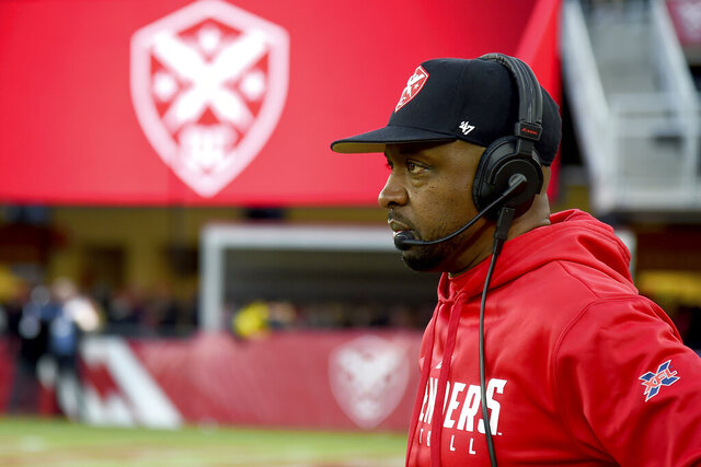 FILE - In this Feb. 8, 2020, file photo, DC Defenders head coach Pep Hamilton looks on during an XFL football game against the Seattle Dragons in Washington. The Los Angeles Chargers are hiring Hamilton as quarterbacks coach, a person familiar with the negotiations told The Associated Press. The person spoke Thursday, April 30, 2020, on condition of anonymity because the deal, first reported by The Athletic, has not been officially announced by the team. (AP Photo/Will Newton, File)
