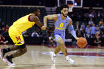 Marquette guard Markus Howard (0) is fouled by Maryland guard Darryl Morsell, left, during the first half of an NCAA college basketball game Sunday, Dec. 1, 2019, in Lake Buena Vista, Fla. (AP Photo/Scott Audette)