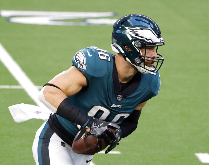 FILE - In this Dec. 27, 2020, file photo, Philadelphia Eagles tight end Zach Ertz catches a pass prior to an NFL football game in Arlington, Texas. Even during a pandemic with ticket sales limited and the off-the-field events drastically scaled back, an event like the Super Bowl also brings with it a heightened risk of human trafficking. Ertz is among a handful of NFL players who've joined the cause to help fight such atrocities. (AP Photo/Michael Ainsworth, File)