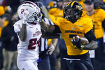 Southern Mississippi running back Darius Maberry (7) tries to fend off Florida Atlantic safety Zyon Gilbert (24) while rushing for a first down during the second half of an NCAA college football game Thursday, Dec. 10, 2020, in Hattiesburg, Miss. (AP Photo/Rogelio V. Solis)