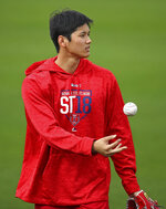 Los Angeles Angels' Shohei Ohtani tosses a baseball during a spring training practice on Tuesday, Feb. 13, 2018, in Tempe, Ariz. (AP Photo/Ben Margot)