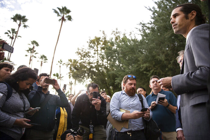 Scott Warren talks to supporters outside the Federal Courthouse after his trial, Wednesday, Nov. 20, 2019 in Tucson, Ariz. Warren was acquitted Wednesday on charges he illegally harbored two Central American immigrants at a camp in southern Arizona operated by a humanitarian group. (Josh Galemore/Arizona Daily Star via AP)