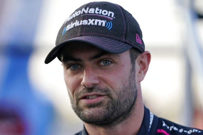 FILE - Jack Harvey is shown before the start of an IndyCar auto race at World Wide Technology Raceway in Madison, Ill., in this Saturday, Aug. 21, 2021, file photo. Rahal Letterman Lanigan Racing confirmed the worst kept secret in IndyCar on Monday, Oct. 11, 2021, when British driver Jack Harvey was officially added to its 2022 lineup. (AP Photo/Jeff Roberson, File)