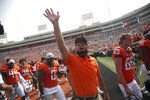 Oklahoma State coach Mike Gundy waves and talks with the crowd after the team's win over Tulsa during an NCAA college football game Saturday, Sept. 19, 2020, in Stillwater, Okla. (John Clanton/Tulsa World via AP)