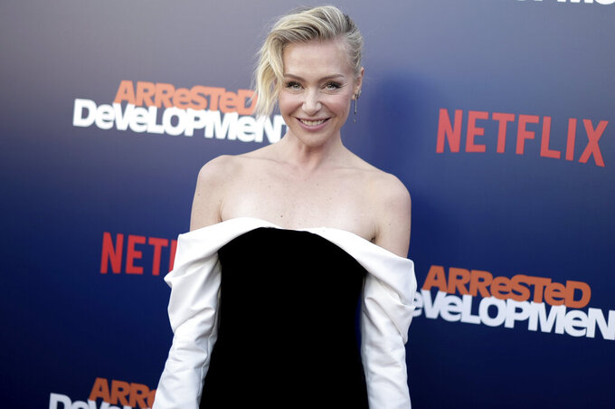 """FILE - In this May 17, 2018 file photo shows Portia de Rossi at the season five premiere of """"Arrested Development"""" in Los Angeles. We are all learning a lot about each other these days and that's especially true with our celebrities. Social distancing has meant they have no army of publicists or glam squad. They're bored and unfiltered — and often incredibly relatable. De Rossi has been teaching herself how to cook during the coronavirus lockdown. It's been an eye-opening experience for the actress— and for her fans.  (Photo by Richard Shotwell/Invision/AP, File)"""