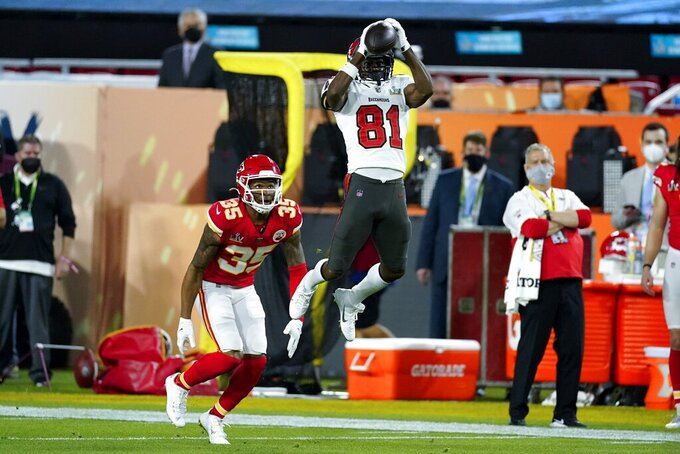 Tampa Bay Buccaneers wide receiver Antonio Brown catches a pass over Kansas City Chiefs cornerback Charvarius Ward during the first half of the NFL Super Bowl 55 football game, Sunday, Feb. 7, 2021, in Tampa, Fla. (AP Photo/Ashley Landis)