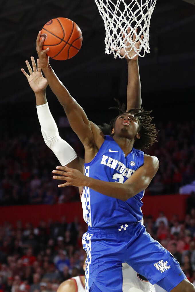Kentucky guard Tyrese Maxey (3) goes in for a shot against Georgia in the first half of an NCAA college basketball game Tuesday, Jan. 7, 2020, in Athens, Ga. (AP Photo/John Bazemore)