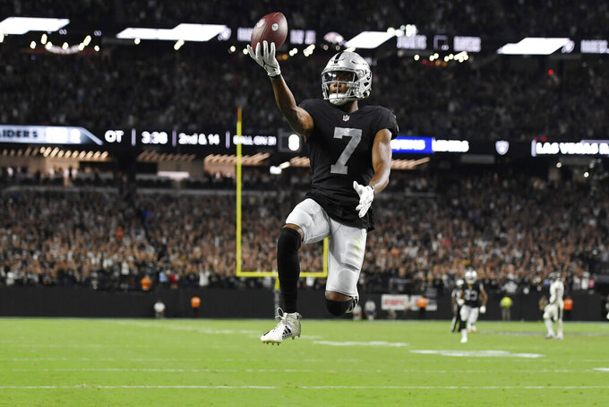 Las Vegas Raiders wide receiver Zay Jones (7) celebrates after scoring a game winning touchdown against the Baltimore Ravens during overtime in an NFL football game, Monday, Sept. 13, 2021, in Las Vegas. (AP Photo/David Becker)