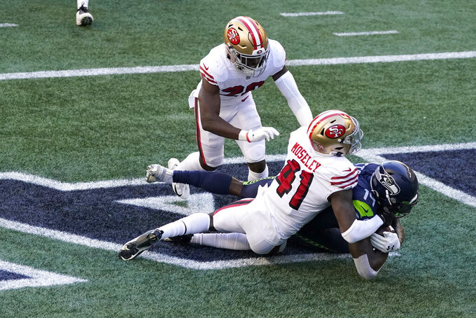 Seattle Seahawks wide receiver DK Metcalf, right, comes down with a catch for a touchdown under San Francisco 49ers cornerback Emmanuel Moseley (41) and free safety Jimmie Ward, upper left, during the first half of an NFL football game, Sunday, Nov. 1, 2020, in Seattle. (AP Photo/Elaine Thompson)