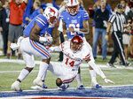 SMU running back Ke'Mon Freeman (2) gets past Houston cornerback Isaiah Johnson (14) to score a touchdown during the second half of an NCAA college football game Saturday, Nov. 3, 2018, in Dallas. SMU won 45-31. (AP Photo/Brandon Wade)