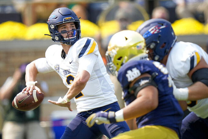 Toledo quarterback Carter Bradley (2) throws while playing Notre Dame in the first half of an NCAA college football game in South Bend, Ind., Saturday, Sept. 11, 2021. (AP Photo/AJ Mast)
