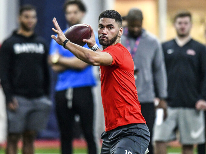 Quarterback Jordan Ta'amu throws a pass during Mississippi's Pro Day at the Manning Center in Oxford, Miss., Friday, March 29, 2019. (Bruce Newman/The Oxford Eagle via AP)