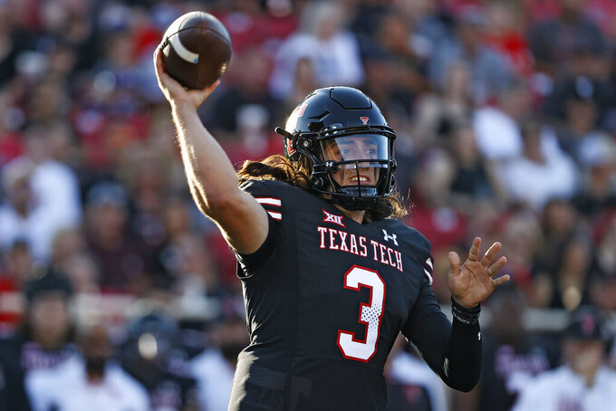 Texas Tech's Henry Colombi (3) passes the ball during the first half of an NCAA college football game against TCU, Saturday, Oct. 9, 2021, in Lubbock, Texas. (AP Photo/Brad Tollefson)