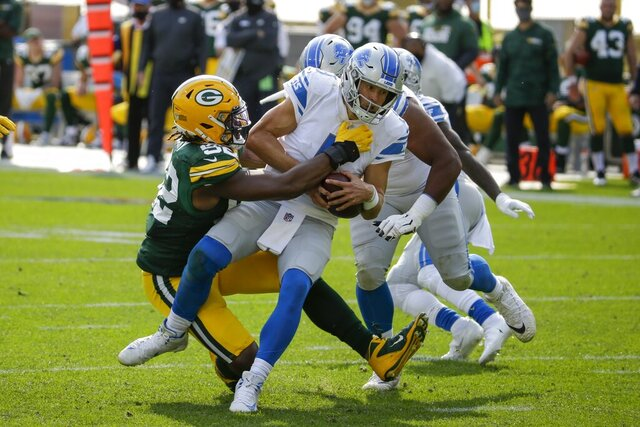 Green Bay Packers' Rashan Gary sacks Detroit Lions quarterback Matthew Stafford during the second half of an NFL football game Sunday, Sept. 20, 2020, in Green Bay, Wis. (AP Photo/Mike Roemer)