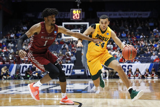 North Dakota State's Tyson Ward (24) drives against North Carolina Central's Zacarry Douglas (1) during the second half of a First Four game of the NCAA men's college basketball tournament Wednesday, March 20, 2019, in Dayton, Ohio. (AP Photo/John Minchillo)