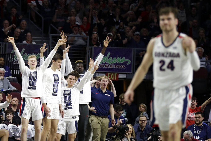 The Gonzaga bench reacts after a three-point basket during the first half of an NCAA college basketball game against San Francisco in the West Coast Conference men's tournament Monday, March 9, 2020, in Las Vegas. (AP Photo/Isaac Brekken)