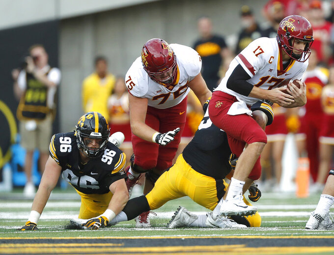 Iowa State quarterback Kyle Kempt, right, runs the ball during the second half of an NCAA college football game, Saturday, Sept. 8, 2018, in Iowa City, Iowa. Iowa won 13-3. (AP Photo/Matthew Putney)