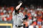 New York Yankees relief pitcher Zack Britton reacts after loading the bases against the Houston Astros during the eighth inning in Game 6 of baseball's American League Championship Series Saturday, Oct. 19, 2019, in Houston. (AP Photo/Eric Gay)