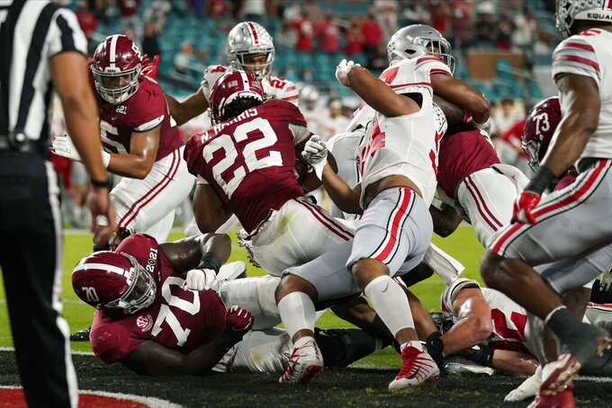 Alabama running back Najee Harris (22) scores a touchdown against Ohio State during the first half of an NCAA College Football Playoff national championship game, Monday, Jan. 11, 2021, in Miami Gardens, Fla. (AP Photo/Lynne Sladky)