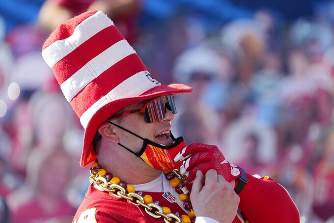 A Kansas City Chiefs fans poses for a picture before the NFL Super Bowl 55 football game between the Kansas City Chiefs and Tampa Bay Buccaneers, Sunday, Feb. 7, 2021, in Tampa, Fla. (AP Photo/David J. Phillip)