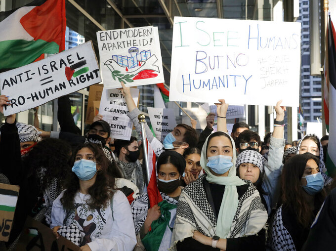 Hundreds of protesters gather and protest in support of Palestinians in front of the Consulate General of Israel on Wednesday, May 12, 2021 in Chicago. (AP Photo/Shafkat Anowar)