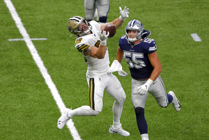New Orleans Saints tight end Josh Hill (89) tires but fails to pull in a pass as Dallas Cowboys outside linebacker Leighton Vander Esch (55) defends in the second half of an NFL football game in New Orleans, Sunday, Sept. 29, 2019. (AP Photo/Bill Feig)