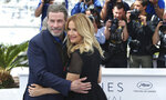 Actors John Travolta, left, and Kelly Preston pose for photographers during a photo call for the film 'Gotti' at the 71st international film festival, Cannes, southern France, Tuesday, May 15, 2018. (Photo by Joel C Ryan/Invision/AP)