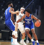 Georgia Tech guard Jose Alvarado defends against Georgia State guard Kane Williams (12) with teammate Eliel Nsoseme, left, during the first half of an NCAA college basketball game, Wednesday, Nov. 25, 2020 in Atlanta. (Curtis Compton/Atlanta Journal-Constitution via AP)