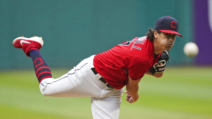 Cleveland Indians starting pitcher Cal Quantrill delivers in the first inning in the first baseball game of a doubleheader against the Detroit Tigers, Wednesday, June 30, 2021, in Cleveland. (AP Photo/Tony Dejak)