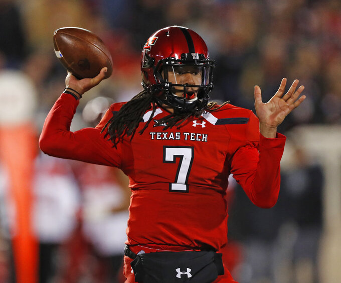 Texas Tech's Jett Duffey throws a pass during the first half of the team's NCAA college football game against Texas, Saturday, Nov. 10, 2018, in Lubbock, Texas. (AP Photo/Brad Tollefson)