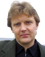 FILE - In this May 10, 2002 file photo, Alexander Litvinenko, former KGB spy is photographed at his home in London. Litvinenko, who defected to Britain and become a vocal Kremlin critic, died in Nov. 2006, three weeks after drinking tea laced with radioactive polonium-210 in London. A public inquiry concluded in 2016 that Russia's security service killed him, likely on Putin's orders. The disappearance of journalist Jamal Khashoggi, during a visit to his country's consulate in Istanbul on Oct. 2, 2018, raises a dark question for anyone who dares criticize governments or speak out against those in power: Will the world have their back? (AP Photo/File)