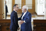 Iranian Foreign Minister Mohammad Javad Zarif, right, gestures to his German counterpart Heiko Maas at the end of their joint press conference in Tehran, Iran, Monday, June 10, 2019. Zarif warned the U.S. on Monday that it