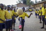 Tresor Ndizihiwe plays soccer with his friends after school at the Kimihurura Primary School in Kigali, Rwanda, on Thursday, June 10, 2021. Tresor says he enjoys playing with others after months at home when he was not allowed to play with his friends or classmates because of the coronavirus pandemic. (AP Photo/Muhizi Olivier)